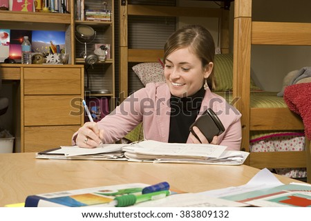 Female student studying in her dormitory - stock photo
