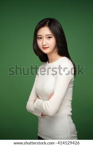 Female student thinking. - stock photo