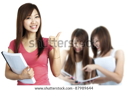 Female student thumbs up with great smile. - stock photo