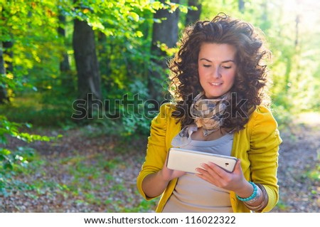 female student using a digital tablet - stock photo