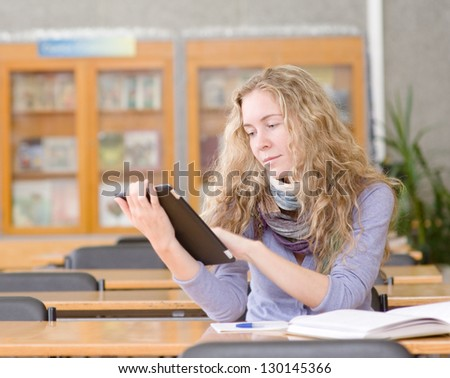 female student with tablet computer in library - stock photo