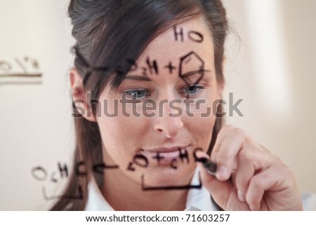 female student works on an equation - stock photo