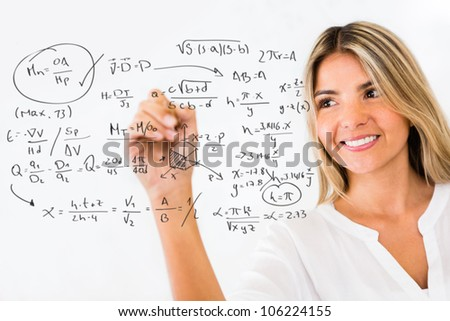 Female student writing math formulas and smiling