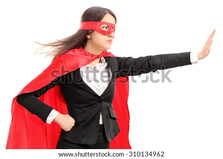 Female superhero making a stop sign with her hand isolated on white background - stock photo