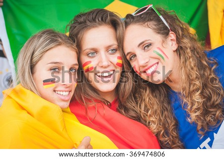 Female Supporters of Different Nationality - Stock Image - stock photo