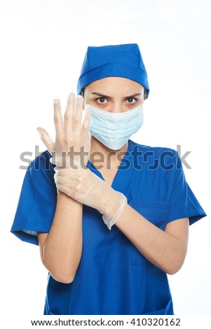 female surgeon getting ready and putting gloves on