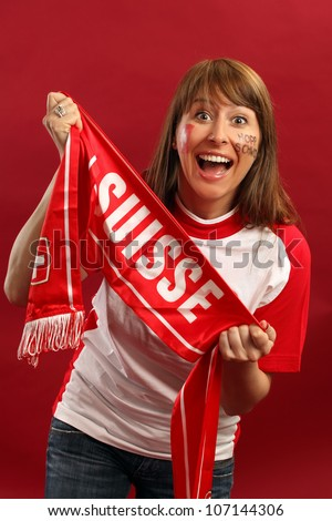 Female Swiss sports fan smiling and cheering for their team. - stock photo
