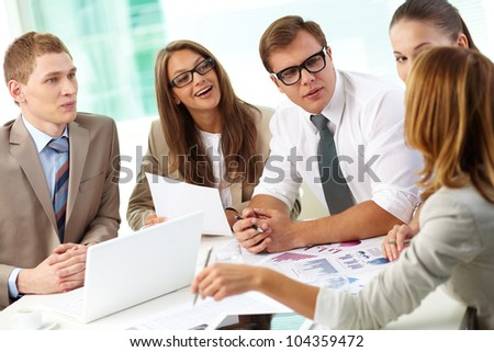 Female team member expressing her business ideas to her colleagues