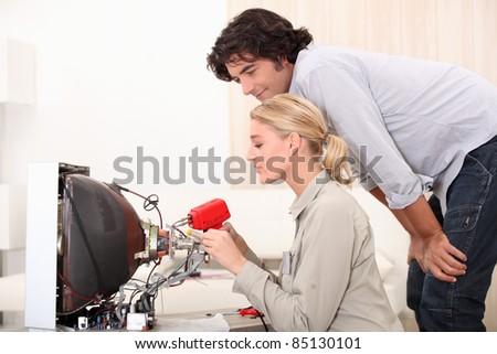 female technician doing repairs - stock photo