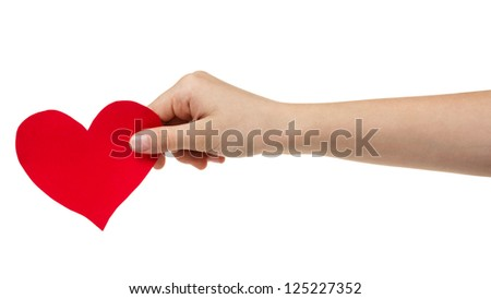 female teen hand holding paper heart, isolated on white - stock photo