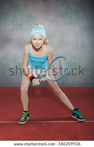 female teenage tennis player on the court - stock photo