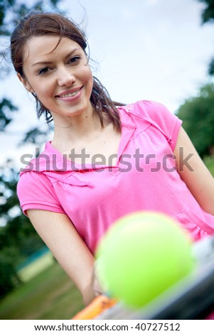 Female tennis player with a racket and a ball - stock photo