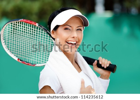 Female tennis player with towel on her shoulders. Active pastime - stock photo