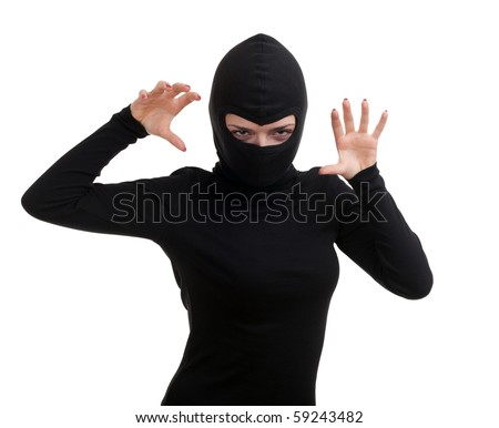 female thief in black clothes and balaclava - stock photo
