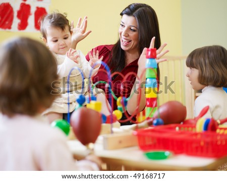 female toddler and 2-3 years girl playing in kindergarten. Horizontal shape