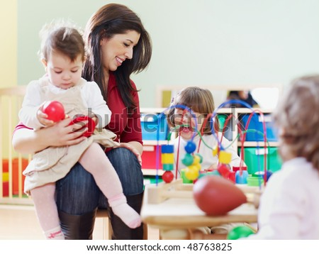 female toddler and 2-3 years girls playing with toys in kindergarten. Horizontal shape, copy space - stock photo