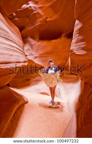 Female tourist exploring the Grand Canyon holding a map - stock photo