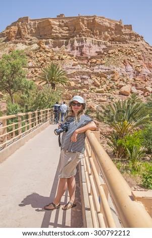 Female tourist on bridge to Ait Benhaddou, Morocco - stock photo