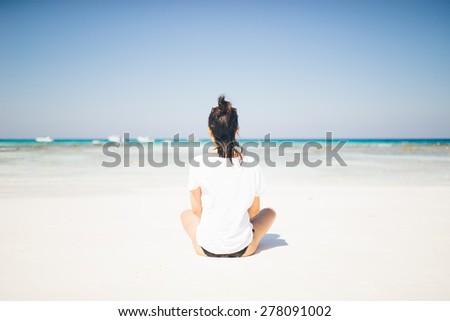 Female tourist relaxing on idyllic tropical beach paradise in Koh Tachai, Thailand - stock photo