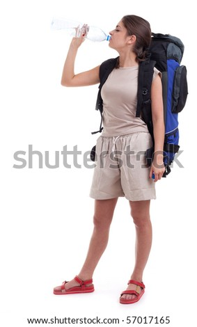 female tourist with backpack drinking water, isolated
