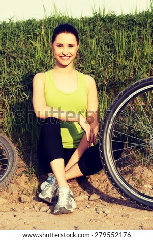 Female tourist with mountine bicycle - stock photo