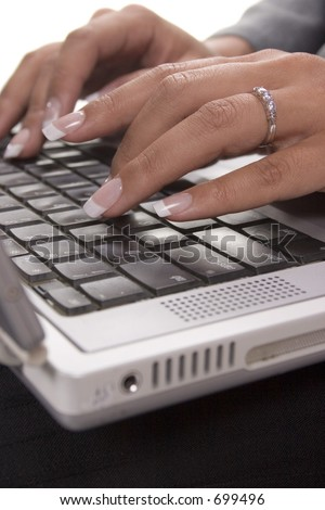 Female typing on a laptop