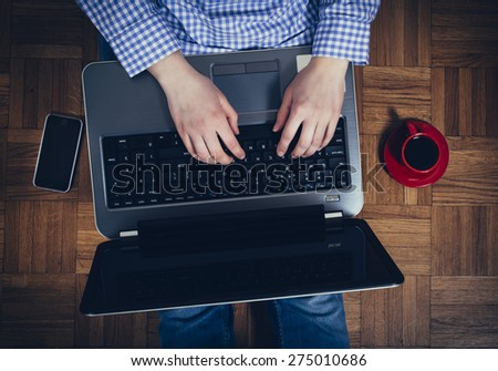 Female typing on laptop computer during the coffee break,selective focus - stock photo
