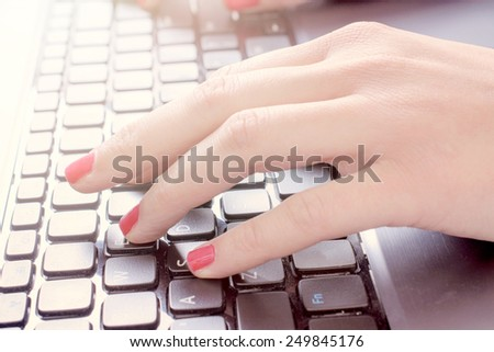 Female typing on the laptop keyboard,selective focus - stock photo