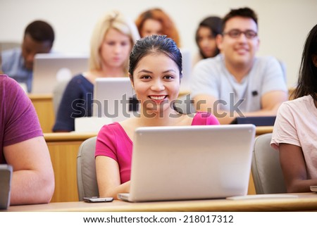 Female University Student Using Laptop In Lecture