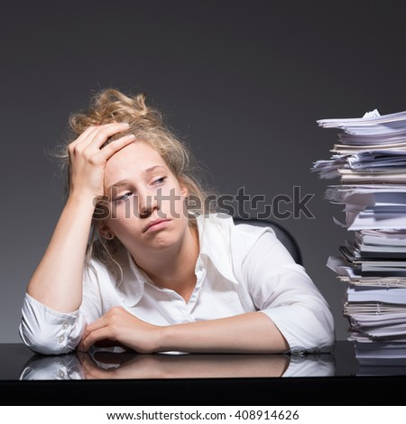 Female victim of mobbing in the office - stock photo