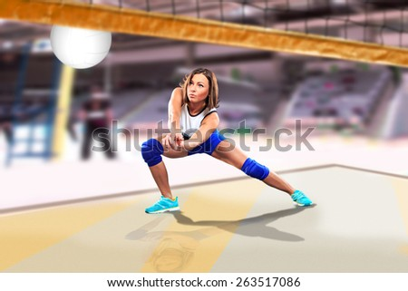 female volleyball player on the volleyball court - stock photo