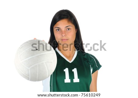 Female volleyball player seen from behind holding a ball out in front of her body.  Shallow depth of field with focus on the girl.