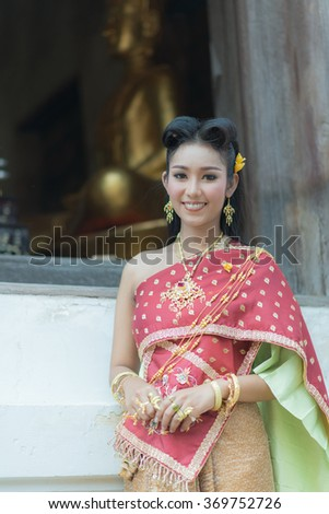 Female wearing typical thai dress with thai identity culture of Thailand - stock photo