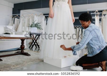Female Wedding Dress Designer Making Adjustment Stock Photo (Edit ...