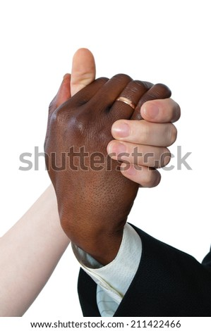 Female white and black man's hand newly married - stock photo