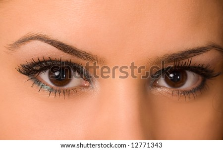 female wide open eyes with long eyelashes macro