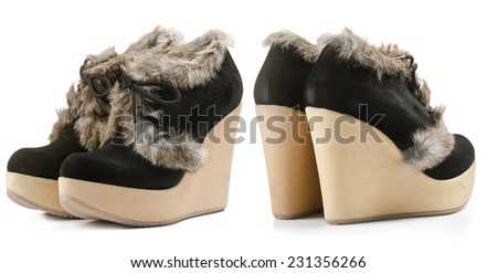 Female winter suede boots isolated on white background