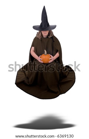 Female witch holding a pumpkin and floating isolated over white - stock photo