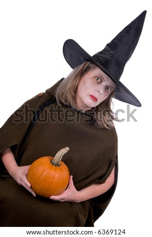 Female witch holding a pumpkin isolated over white - stock photo