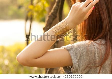 female with bracelets - stock photo