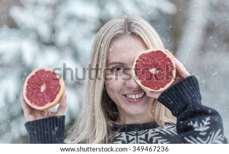 Female with grapefruit eyes at winter.