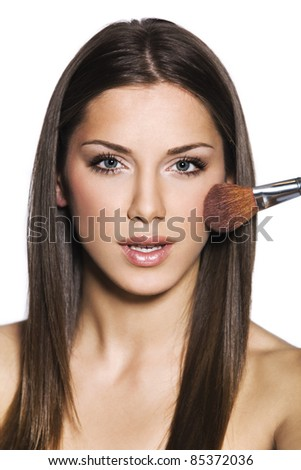 female with makeup brush - stock photo
