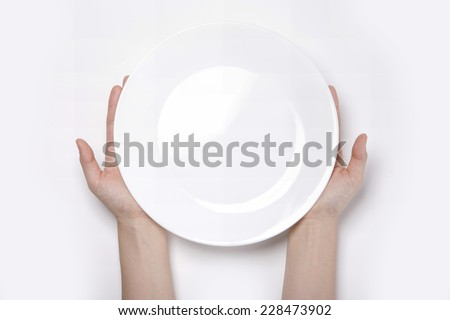 Female(woman) two hands hold(support) a white dish(plate) isolated white and top view. - stock photo