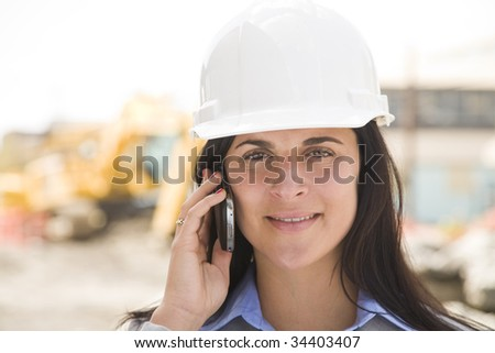 female worker at a construction site - stock photo