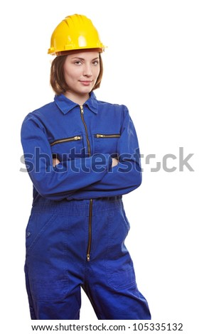 Female worker in blue overall and yellow safety helmet - stock photo