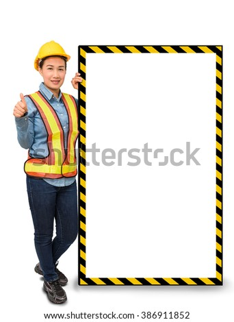 female worker with Protection Equipment, posing side of big white banner, thumb up and looking at camera and copy space, isolated on white background