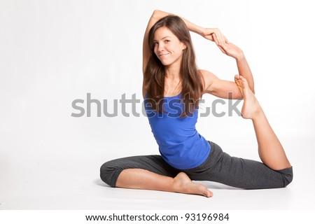 Female yoga instructor doing yoga pose - stock photo
