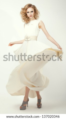 Femininity. Fashion Model in Long Light Dress. Smart Casual Clothes. Summertime Collection - stock photo