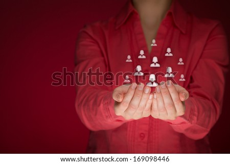 Feminism, female customer care, care for employees, labor union, CRM, and life insurance concepts. Protecting gesture of woman or personnel with icons representing group of woman.  - stock photo