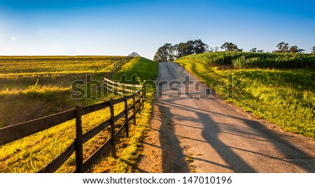 Fence along a farm road in rural York County, Pennsylvania. - stock photo